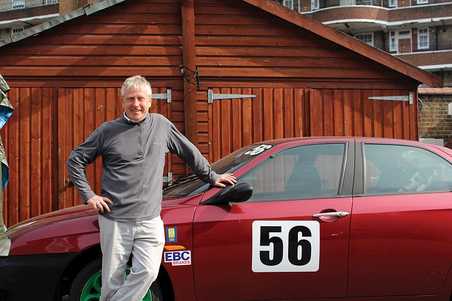 learner Paul Curran standing in front of a car which has the number 56 against it.