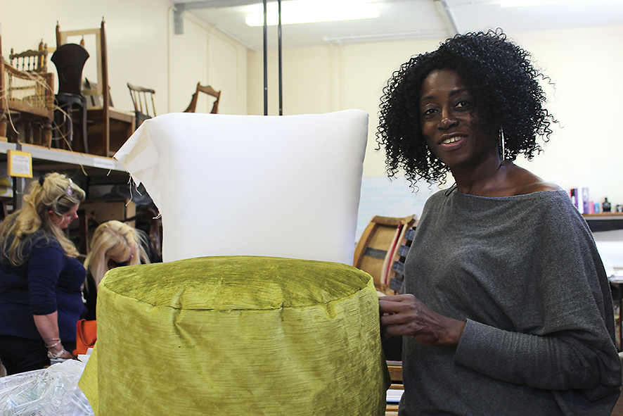 Learner Janette Lindsey posing with her upholsery work