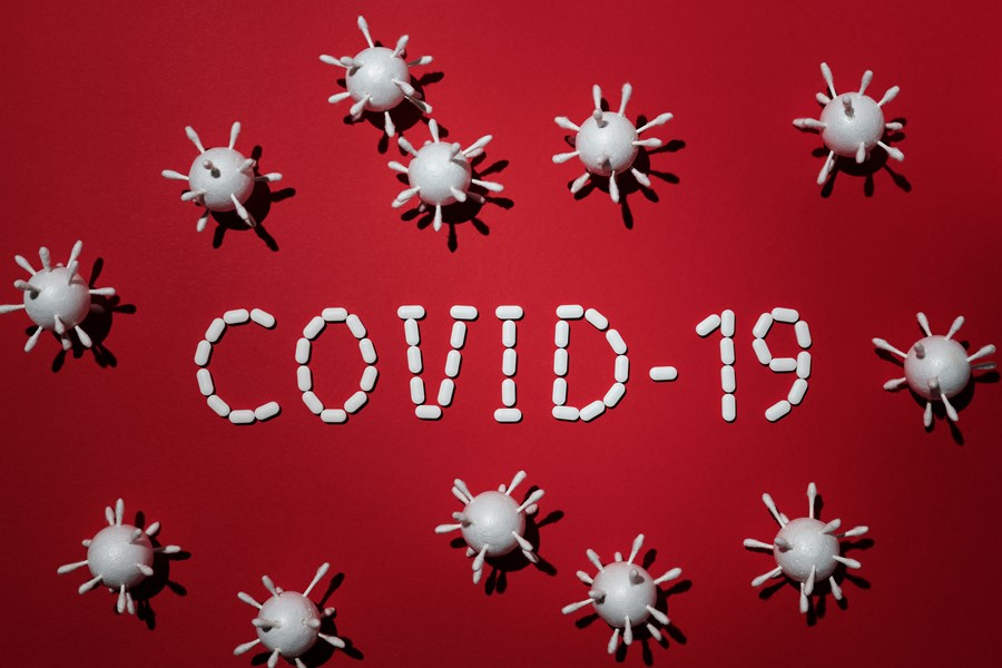 Covid-19 bacteria cells on a red background