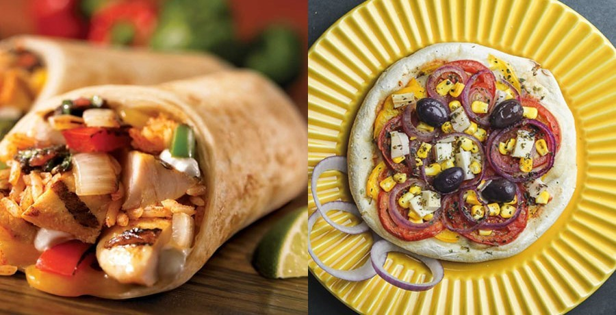 Chicken wrap and pizza on a yellow plate