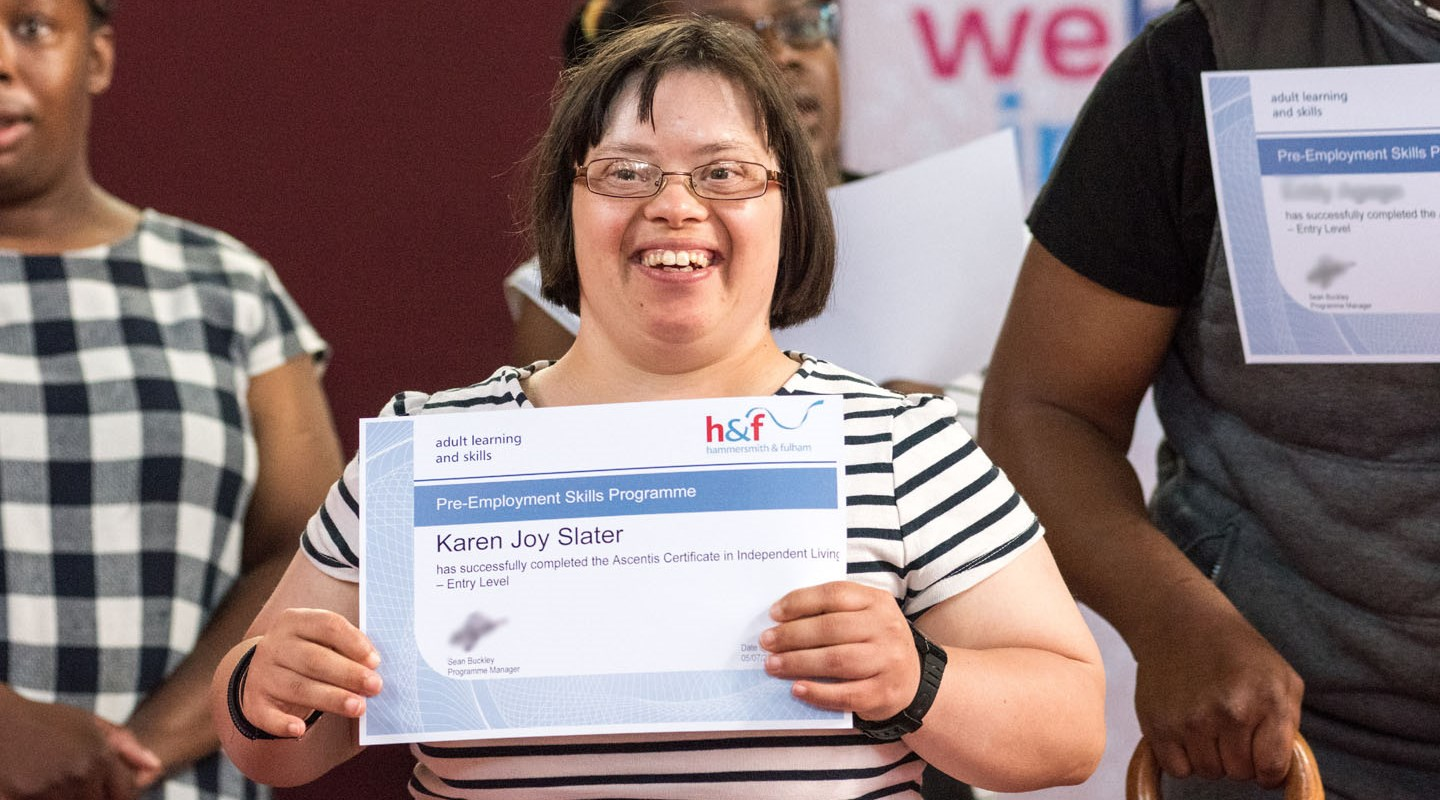 Woman smiling while holding a certificate