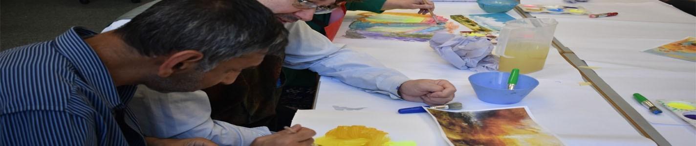 Man painting using yellow tones