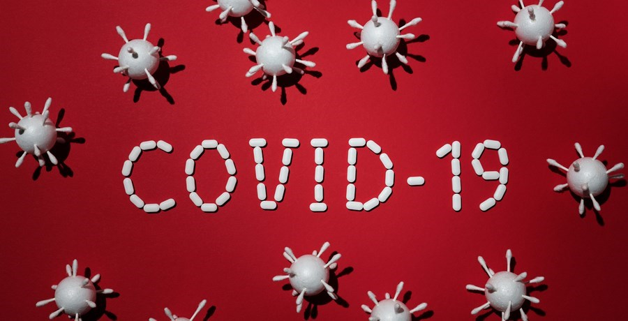 White 3d covid-19 cells on a red background