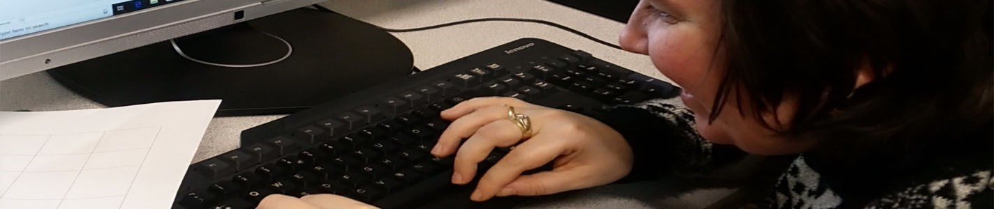 Woman typing on a keyboard