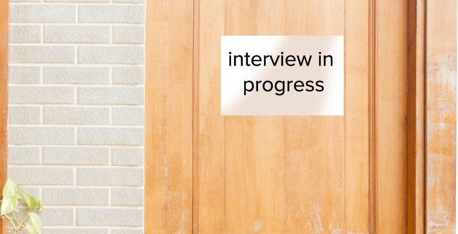 """Notice on a wooden door """"Interview in Progress"""""""